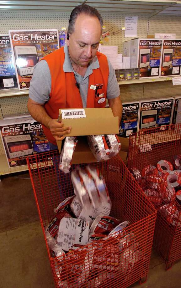 Southeast Texas are getting ready for low temperatures forecast for the end of the week.  Over at M&D Supply, Pat Salinas, refills a bin with pipe insulating wrap kits.    Dave Ryan/The Enterprise Photo: Dave Ryan / Beaumont