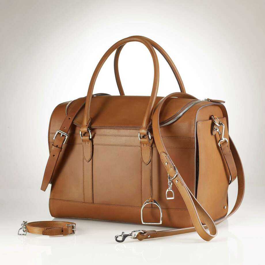 Leather dogcarrier and Stirrup leash by Ralph Lauren Pup; $1,950 and $495 atralphlauren.com. / RalphLauren