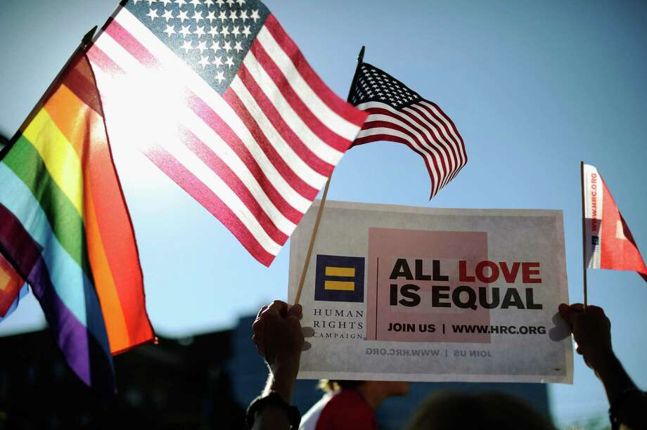 Same-sex marriage supporters celebrate the U.S. Supreme Court ruling striking down  the Defense of Marriage Act earlier this year. Bans on gay marriage in certain states, including Texas, still exist. Photo: Kevork Djansezian / Getty Images