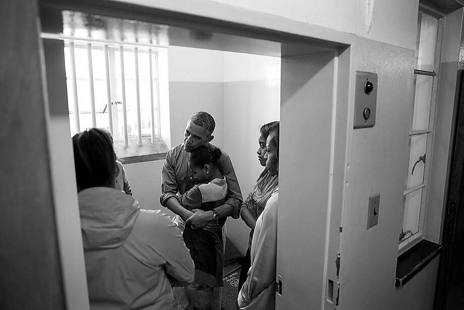 President Obama and family listened to former prisoner Ahmed Kathrada during their tour of Robben Island Prison in Cape Town, South Africa, in June. Photo: Pete Souza, Pete Souza/The White House