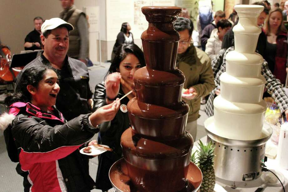 Visitors to the State Museum's Chocolate Expo try out the chocolate fountain. (Courtesy State Museum)