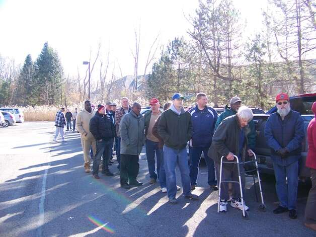 Tully Rinckey and Hannaford Supermarkets provided free turkeys Monday to active duty and retired military personnel for Thanksgiving through the fifth annual ?Turkeys for Veterans? program as a way to show appreciation for their sacrifices. Turkeys were hand-delivered to about 200 active duty service members and veterans at the law firm?s headquarters at 441 New Karner Road. Here, a long line of veterans and troops wait in line. (Submitted photo)