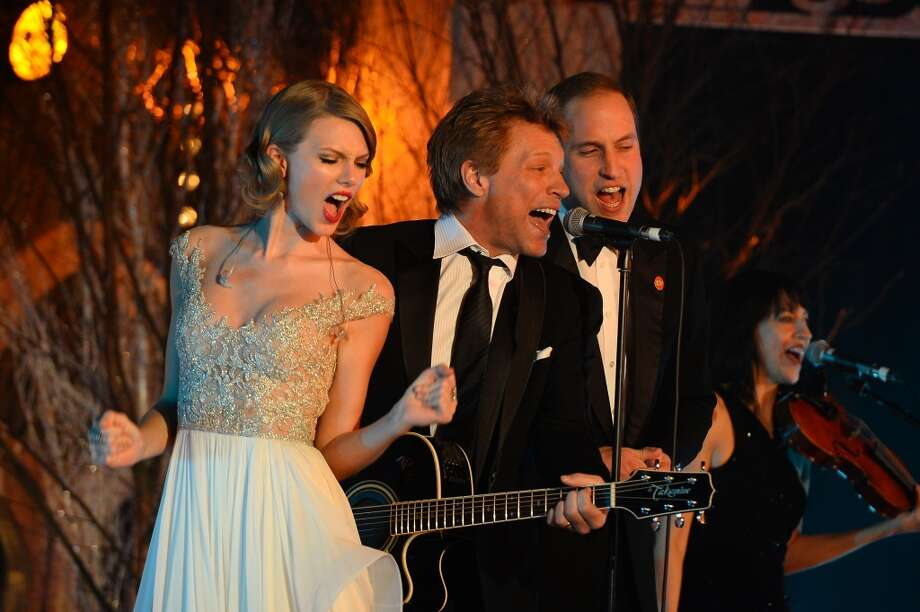 Taylor Swift, Jon Bon Jovi and Prince William, Duke of Cambridge perform during the Winter Whites Gala In Aid Of Centrepoint on November 26, 2013 in London, England.  (Photo by Ben Pruchnie/Centrepoint/Getty Images for Centrepoint) Photo: Ben Pruchnie/Centrepoint