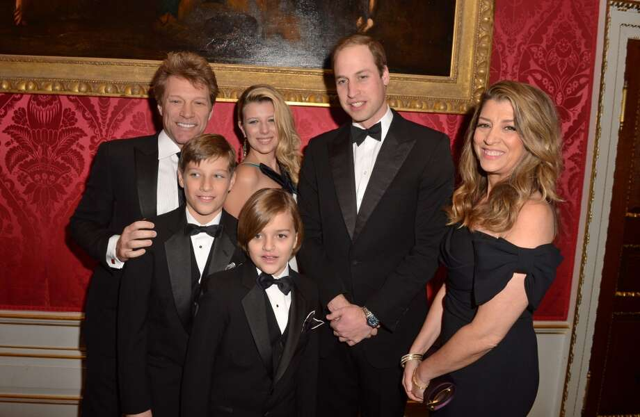 Prince William, Duke of Cambridge meets Jon Bon Jovi (L) and wife Dorothea Hurley (R) and their children Jacob (2L), Stephanie (3L) and Romeo (front, 4L) at Kensington Palace for the Centrepoint Winter Whites Gala on November 26, 2013 in London, England.  (Photo by Dominic Lipinski - WPA Pool/Getty Images) Photo: WPA Pool, Getty Images
