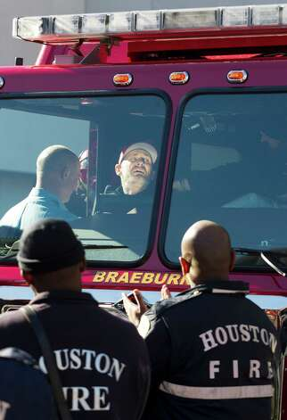 Houston Fire Department Capt. Bill Dowling is seated in HFD Engine 68 for his ride home as he is released from the hospital Wednesday, Nov. 27, 2013, in Houston. Dowling has be