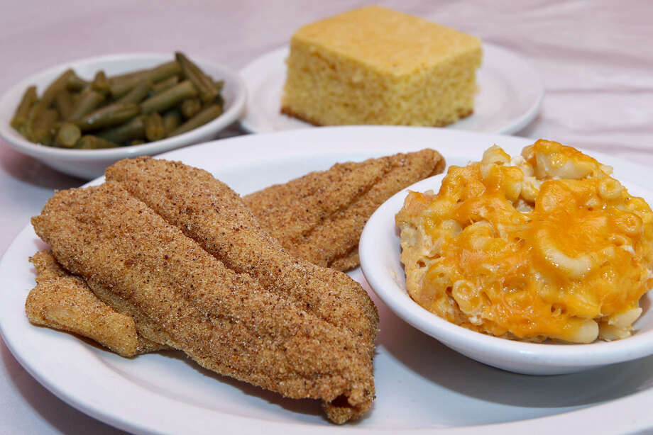 Mrs. Kitchen Soul Food Restaurant and Bakery on East Commerce Street offers fried catfish with a variety of sides, including the baked mac and cheese and green beans seen here. Photo: Photos By Cynthia Esparza / For The Express-News