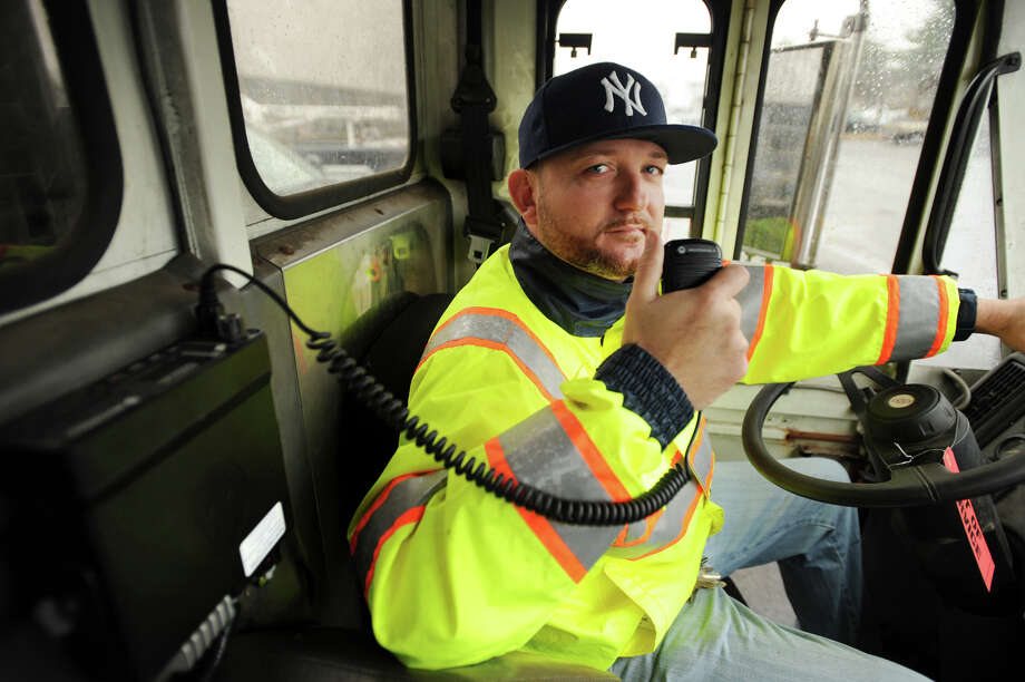 Roadway foreman Craig Nadrizny shows the new radio system employed in the city's snow removal and emergency operations equipment at the Public Facilities Municipal Garage in Bridgeport, Conn. on Wednesday, November 27, 2013. Photo: Brian A. Pounds / Connecticut Post