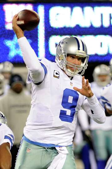 Dallas Cowboys quarterback Tony Romo (9) throws a pass during the first half of an NFL football game