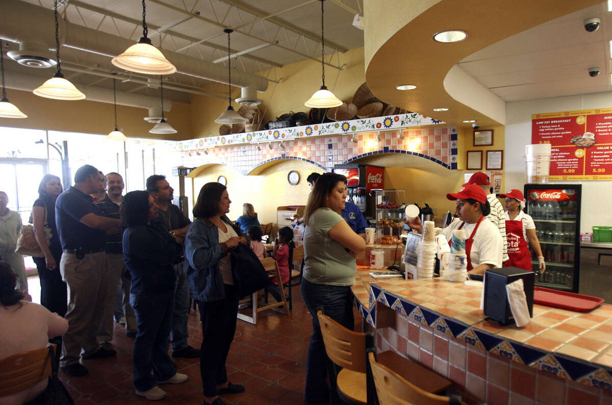 Customers stand in line at Dona Tota Gorditas. Doña Tota Gorditas has 200 locations in Mexico. This is its first restaurant in the U.S. There are plans to open more.