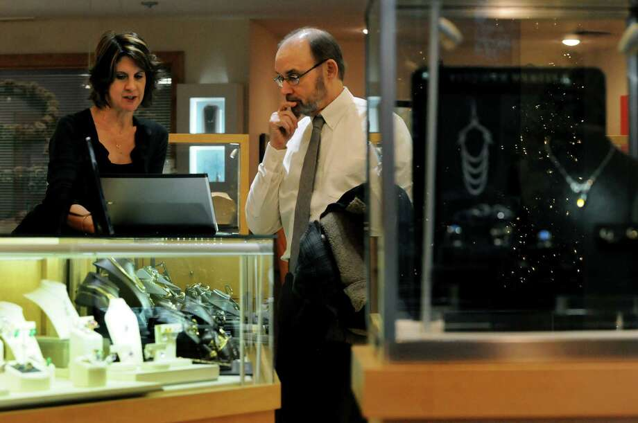Sales professional Sarah Otto, left, assists George Dowse of Delmar with a gift selection on Wednesday, Nov. 27, 2013, at Northeastern Fine Jewelry in Guilderland, N.Y. (Cindy Schultz / Times Union) Photo: Cindy Schultz / 00024833A