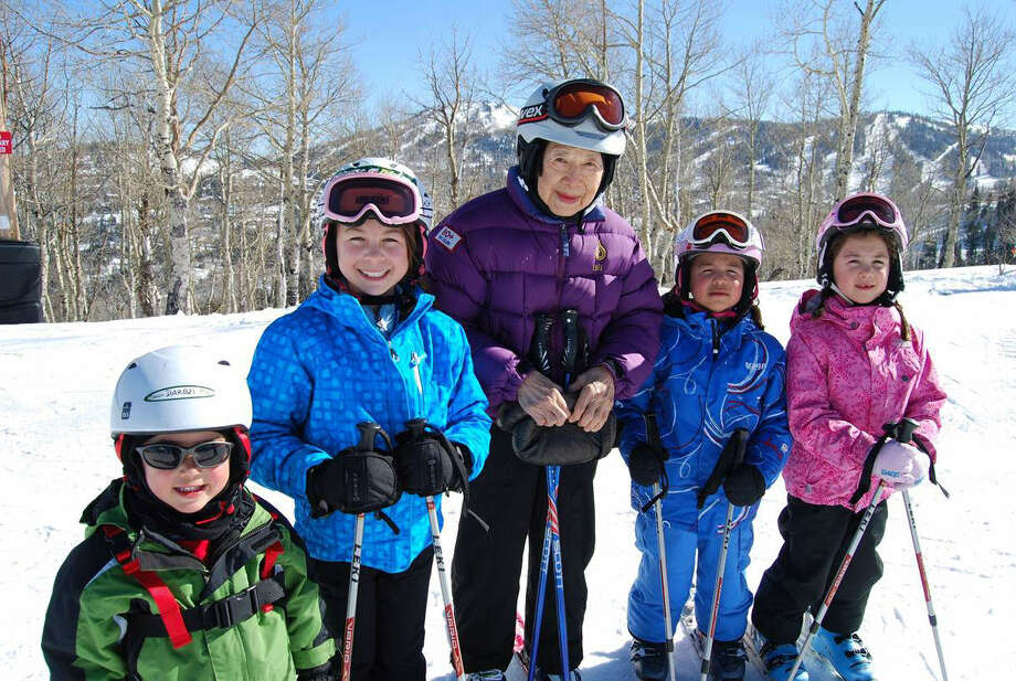 70 + Ski Club member Dee Wang, 89, of Shelburne, Vt., skis with her great-grandchildren in Park City, Utah.