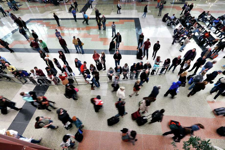 On the busiest travel day of the year, family and friends watch for arrivals of loved ones, at Denver International Airport, Wednesday, Nov. 27, 2013. Denver's airport was busy Wednesday with holiday travelers but storms on the East Coast did not ripple out into the widespread meltdown that had been feared. (AP Photo/Brennan Linsley) ORG XMIT: COBL101 Photo: Brennan Linsley / AP