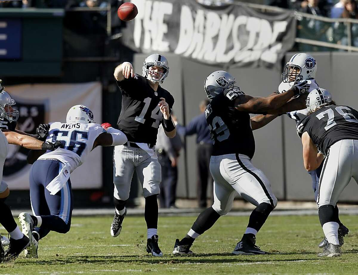 Matt McGloin (14) completed a short pass in the first quarter Sunday November 24, 2013 in Oakland, Calif. The Oakland Raiders vs the Tennessee Titans Sunday November 24, 2013 at O.co Coliseum.