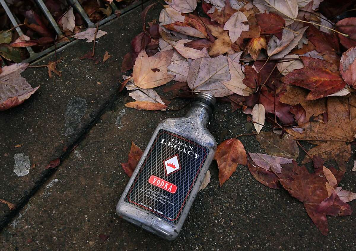 An empty vodka bottle is left in the gutter on 4th Street in downtown San Rafael, Calif. on Wednesday, Nov. 20, 2013. A recent uptick in the transient homeless population has frustrated downtown merchants.