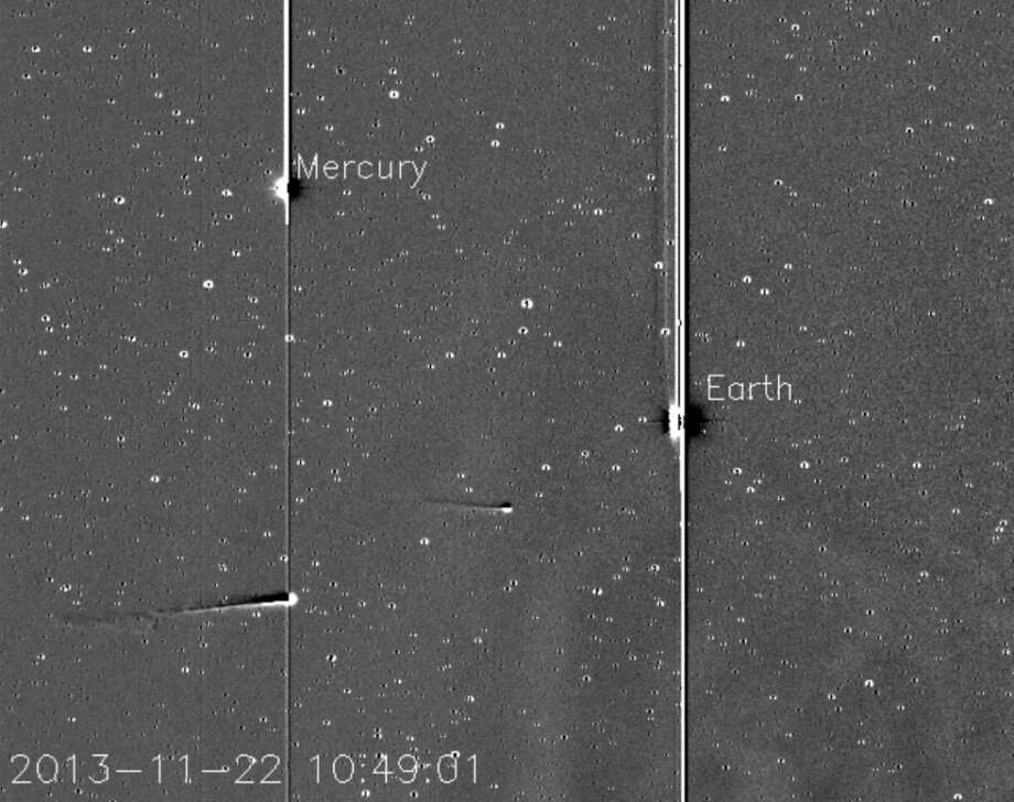 This still image from the video shows comet ISON just passing the plane of Mercury, with Comet Encke ahead and slightly above on Nov. 22, 2013. The sun is located off-screen to the right.SciGuy: Comet ISON wounded, but not dead after grazing sun Photo: Karl Battams/NRL/NASA STEREO/CIOC