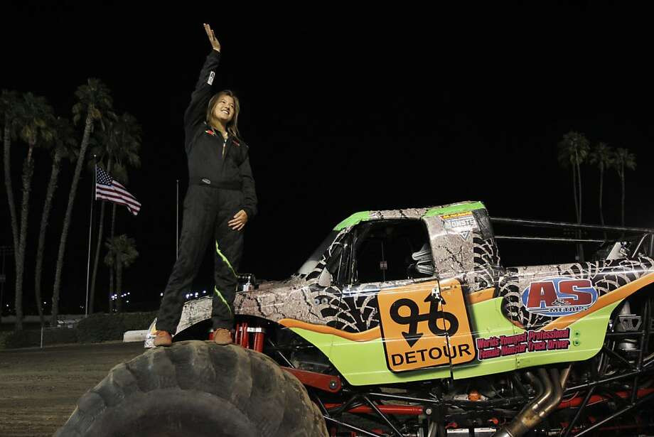 Rosalee Ramer waves to the crowd before a September monster truck event at the L.A. County Fairgrounds. Photo: Leah Millis, The Chronicle