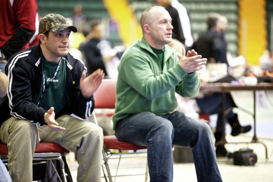 Shen Coaches Rob Weeks, right, grean, and Frank Popolizio, left, blue with hat on, clap hands as shen wrestler Will Mars wins the 171lb. wrestlebacks over Columbia, ny Alex Garrigon at section2 glans falls civic center on 2/11/11 at 7:06pm (Justin Cummings - special to the times union)