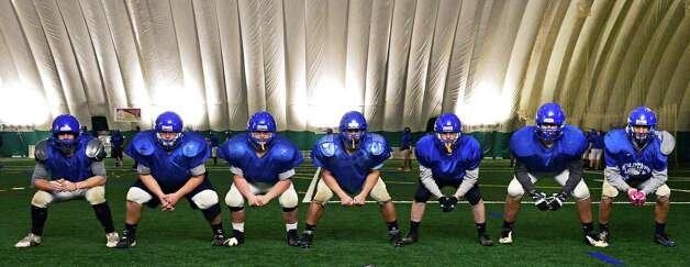 Queensbury starting offensive line, from left,:  Jeff Underhill, Marc Lambert, Kyle Gross, Ted Nolan, Ben Willows, Nick Marasco and Keeghan O'Leary during practice in the dome at Adirondack Sports Complex Tuesday Nov. 26, 2013, in Queensbury, NY.  (John Carl D'Annibale / Times Union) Photo: John Carl D'Annibale / 00024813A