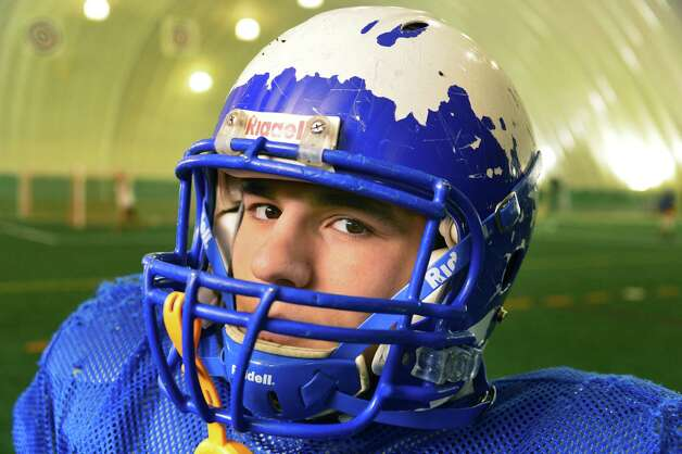 Queensbury nose guard Frank Nassivera's paint chipped helmet tells the story of a hard fought season during practice in the dome at Adirondack Sports Complex Tuesday Nov. 26, 2013, in Queensbury, NY.  (John Carl D'Annibale / Times Union) Photo: John Carl D'Annibale / 00024813A