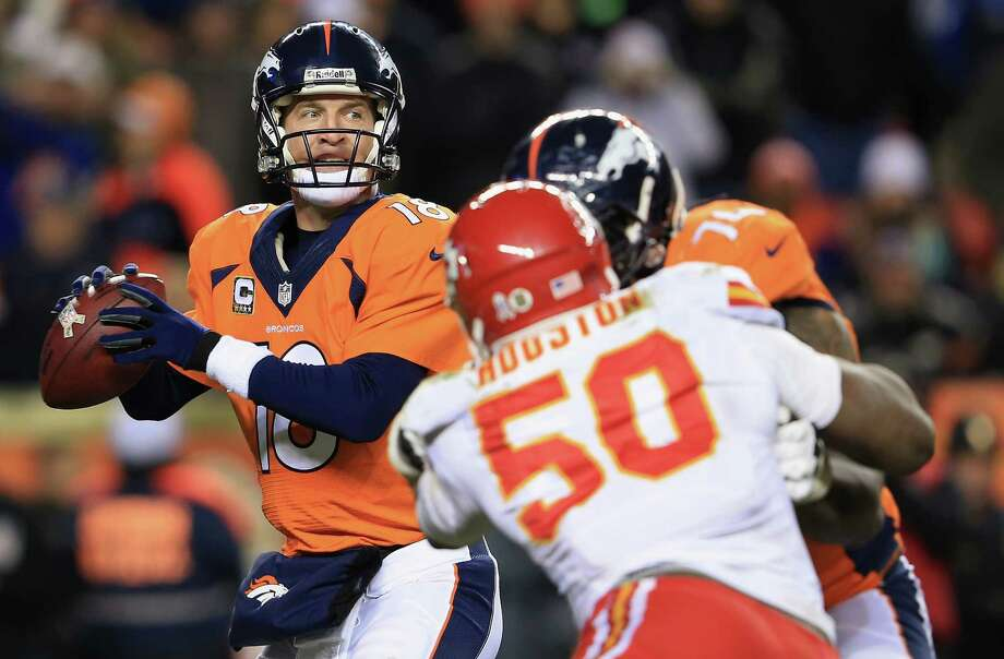 DENVER, CO - NOVEMBER 17:  Quarterback Peyton Manning #18 of the Denver Broncos drops back to pass as tackle Orlando Franklin #74 of the Denver Broncos blocks outside linebacker Justin Houston #50 of the Kansas City Chiefs at Sports Authority Field at Mile High on November 17, 2013 in Denver, Colorado. The Broncos defeated the Chiefs 27-17.  (Photo by Doug Pensinger/Getty Images) Photo: Doug Pensinger / 2013 Getty Images