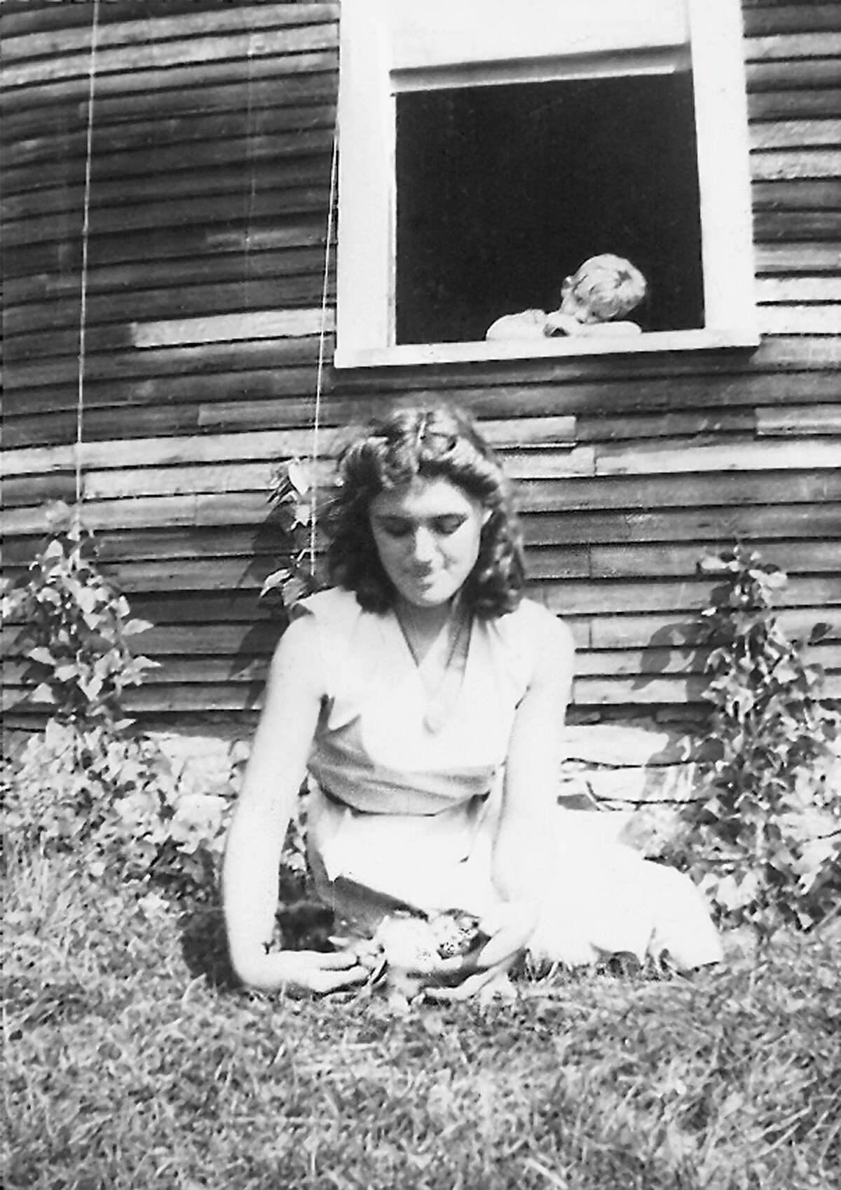 Gloria Stubing Rist with a cousin, Johnny Baker, behind her in the late 1930s. Rist has written a memoir of her impoverished Adirondack childhood. (Photo contributed by SUNY Press.)