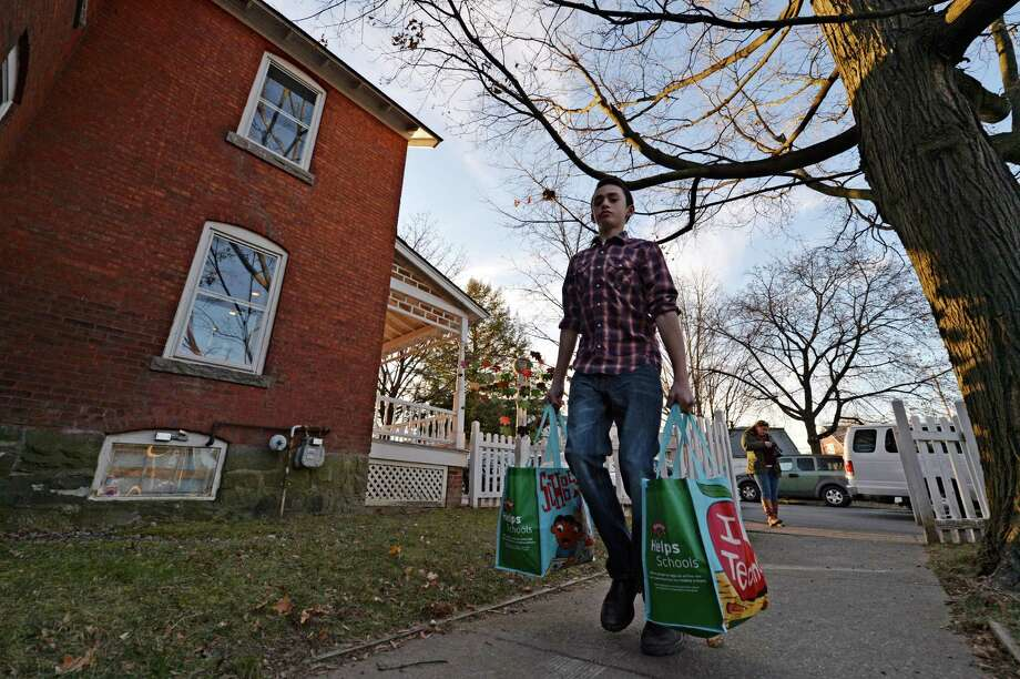 T. J. Tracy, 13  brings a food donation to the Franklin Community Center Monday afternoon Nov 25, 2013, in Saratoga Springs, N.Y.        (Skip Dickstein/Times Union) Photo: SKIP DICKSTEIN / 00024777A