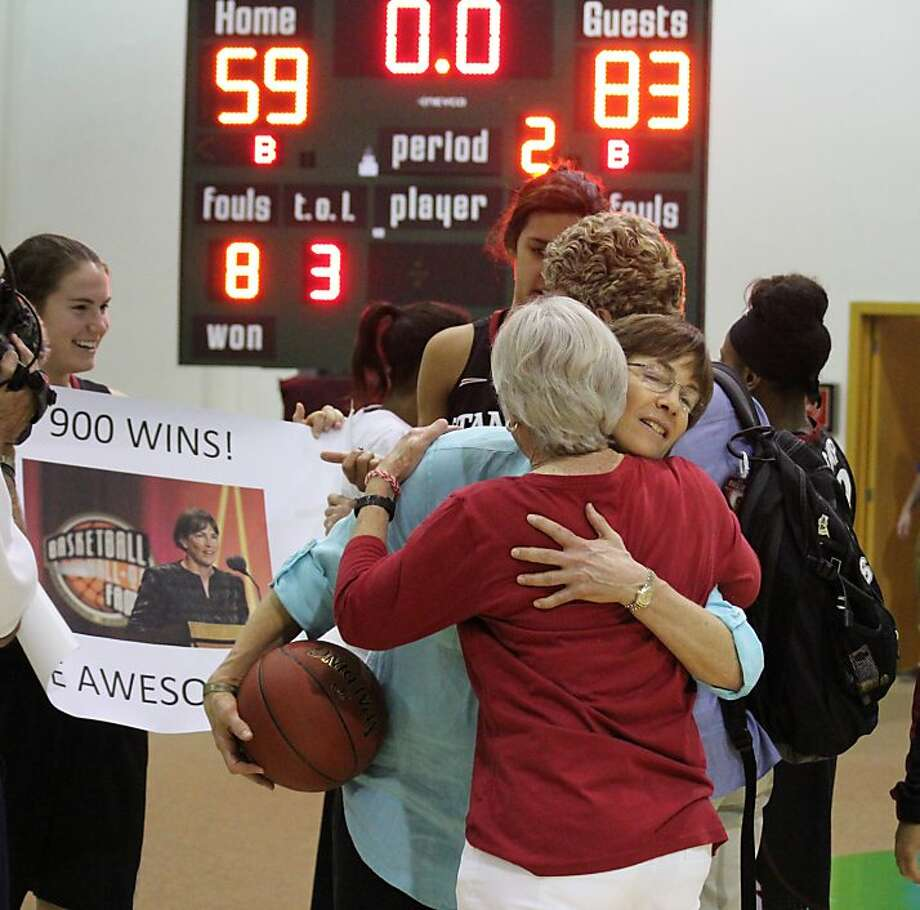 Stanford head coach Tara VanDerveer (facing) is congratulated for No. 900. Photo: Casey Murphy, Associated Press