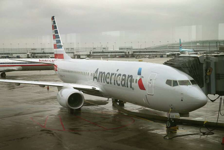 American Airlines parent AMR Corp. intends to complete a $17.2 billion merger with US Airways on Dec. 9. Photo: Scott Olson / Getty Images