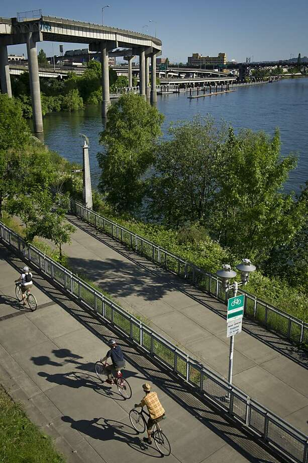 The Waterfront Bike Trail in Portland runs along the Willamette River and includes the Eastbank Esplande, part of a 40-mile loop to connect park sites. Photo: Andrea Johnson Photography, Special To The Chronicle