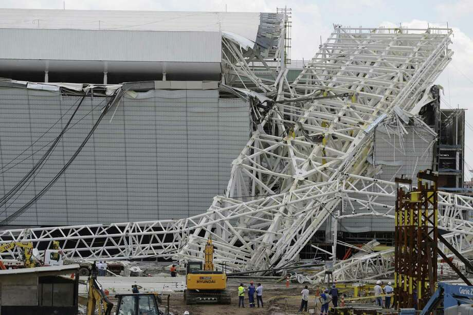 Sao Paulo's Itaquerao stadium was damaged when a construction crane crashed into a 500-ton metal structure, which cut through the stadium's outer walls. Photo: Nelson Antoine / Associated Press