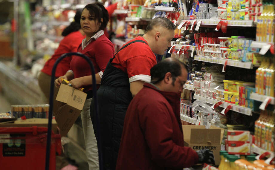 Target employees stock shelves at the Target store at 11311 Bandera road Tuesday November 19, 2013. Employees there are preparing for Black Friday. Black Friday is the Friday after Thanksgiving Day and is regarded by many as the start of the Christmas shopping season. Photo: JOHN DAVENPORT, STAFF / ©San Antonio Express-News/Photo may be sold to the public