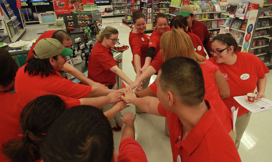 Target employees show solidarity as they huddle at a store in San Antonio last week. They were preparing for crowds of shoppers looking for bargains during the Thanksgiving weekend. Photo: JOHN DAVENPORT, STAFF / ©San Antonio Express-News/Photo may be sold to the public