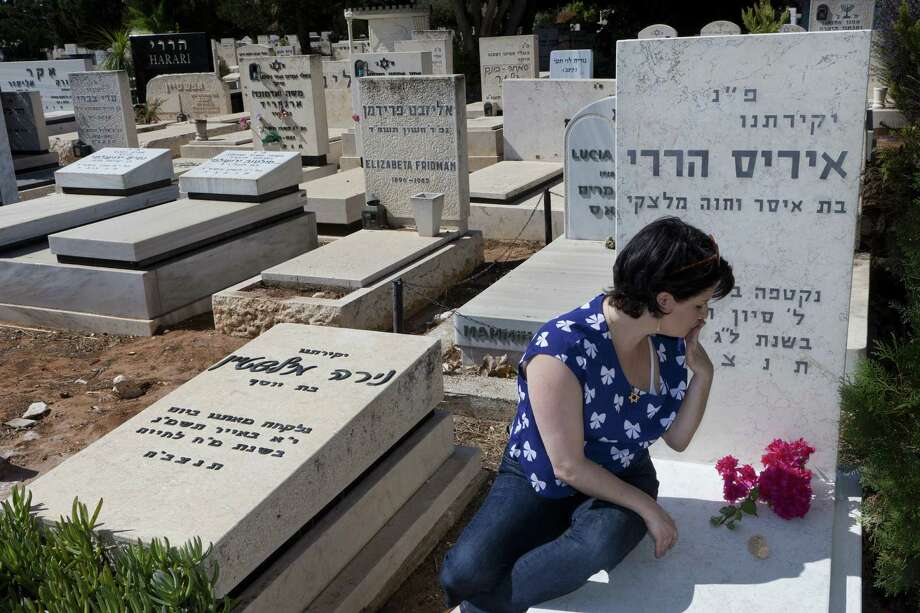 Nili Harari, who tested positive for one of the genetic mutations common in Ashkenazi Jews that can cause breast cancer, visits the grave of a loved one. Photo: Rina Castelnuovo / New York Times