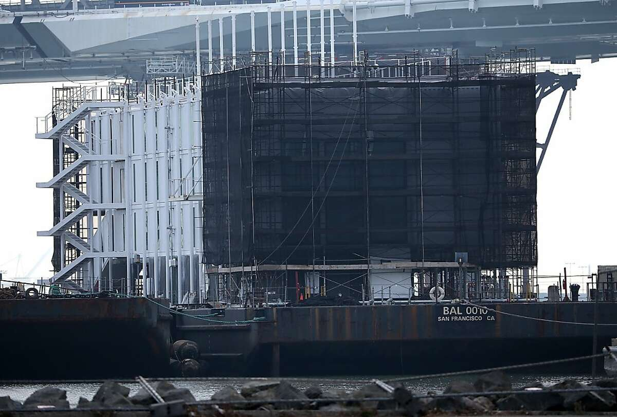 SAN FRANCISCO, CA - OCTOBER 30: A barge under construction is docked at a pier on Treasure Island on October 30, 2013 in San Francisco, California. Mystery barges with construction of shipping containers have appeared in San Francisco and Portland, Maine, prompting online rumors that the barges are affiliated with a Google project. (Photo by Justin Sullivan/Getty Images)