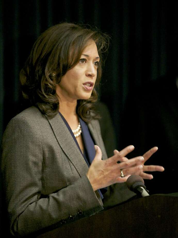California's attorney general Kamala Harris addresses the issue of inmate recidivism during a news conference in Los Angeles Wednesday, Nov. 20, 2013. Harris said a new division of her department will seek funding for programs that will target those who are most susceptible to commit more crimes after being released from jails and prisons. The entity also will have a database that will identify risk factors and trends to help local law enforcement better address the issue. (AP Photo/Damian Dovarganes) Photo: Damian Dovarganes, Associated Press