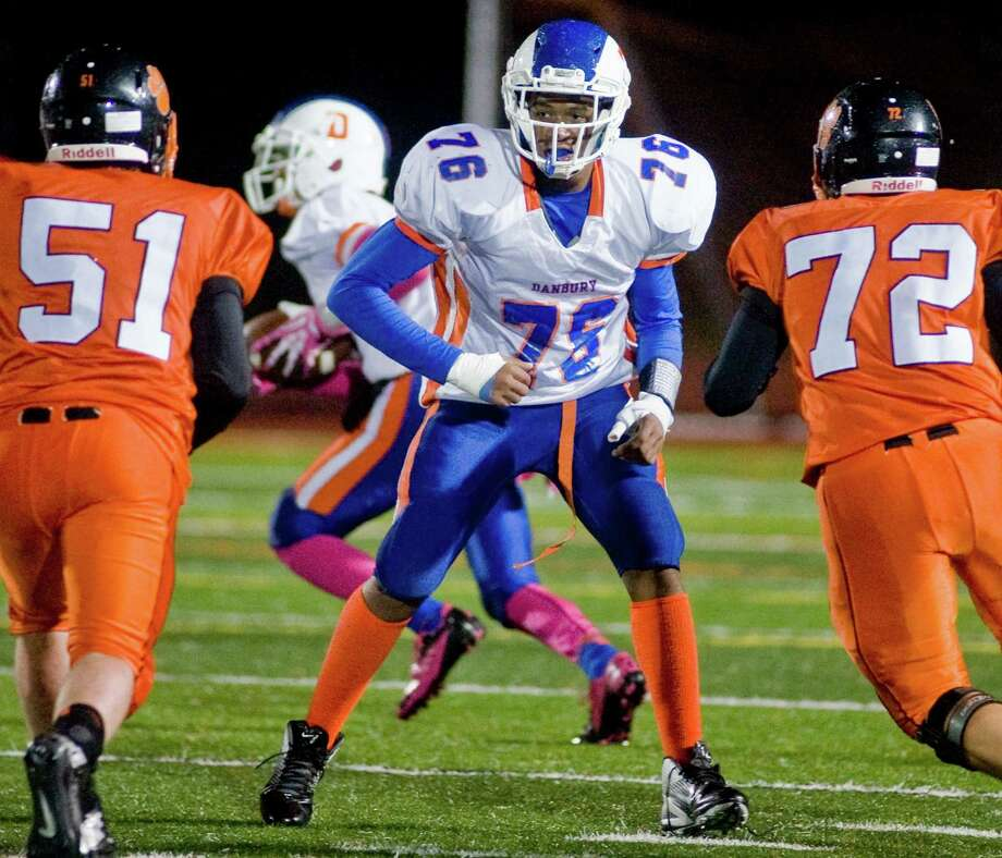 Danbury High School's Michael Reid stands ready to protect his runner in a game against Ridgefield High School, played at Ridgefield. Wednesday, Nov. 27, 2013 Photo: Scott Mullin / The News-Times Freelance