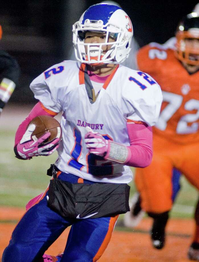 Danbury High School's Anfreny Ith carrying the ball in a game against Ridgefield High School, played at Ridgefield. Wednesday, Nov. 27, 2013 Photo: Scott Mullin / The News-Times Freelance