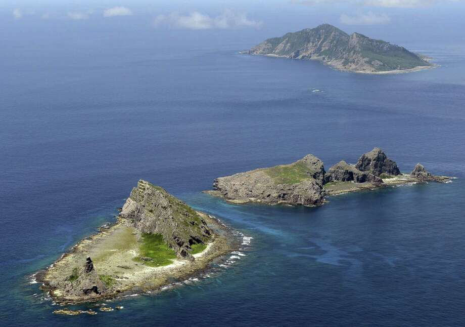 The tiny islands in the East China Sea, called Senkaku in Japanese and Diaoyu in Chinese, are at the center of a dispute between the two nations. China said Wednesday  it had monitored two unarmed U.S. bombers that flew over the East China Sea in defiance of Beijing's declaration. Photo: Kyodo News / Associated Press