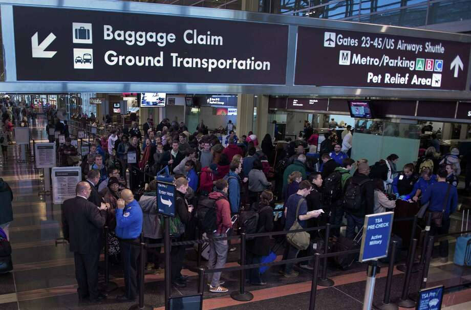 Travelers line up on Thanksgiving eve for a security screening before boarding their flights at Ronald Reagan National Airport in the nation's capital. Photo: Paul J. Richards / Getty Images