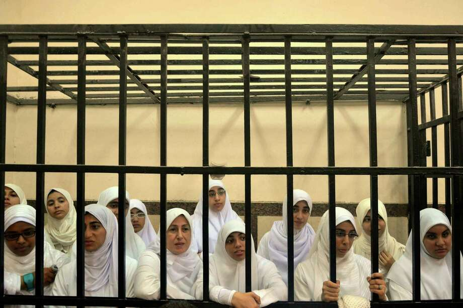The female protesters, shown in the defendants cage in Alexandria, were convicted on charges related to an Oct. 31 protest. Photo: El Shorouk Newspaper / Associated Press