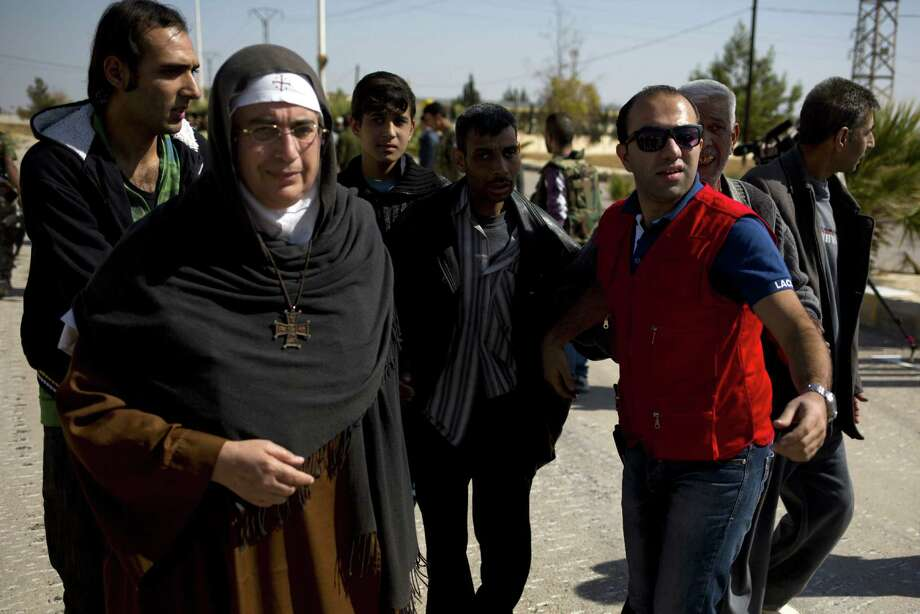 Mother Superior Agnes-Mariam of the Cross has thrust herself into the role of go-between, arranging cease-fires, organizing pro-government media trips, conducting speaking tours and criticizing the uprising against President Bashar Assad. Photo: Dusan Vranic / Associated Press