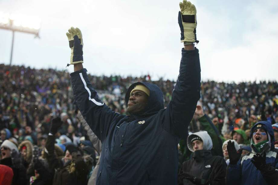 Former San Antonio Spurs center David Robinson cheers for Notre Dame against Brigham Young University. Photo: Photos By Taylor Glascock / For The San Antonio Express-News