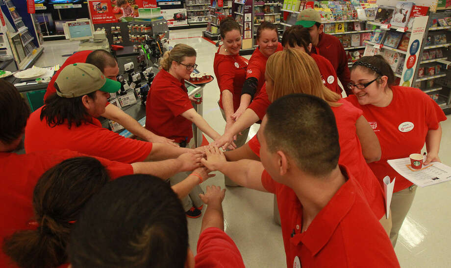 Target employees show solidarity in the store at 11311 Bandera Road in preparation for Black Friday. Photo: John Davenport / San Antonio Express-News