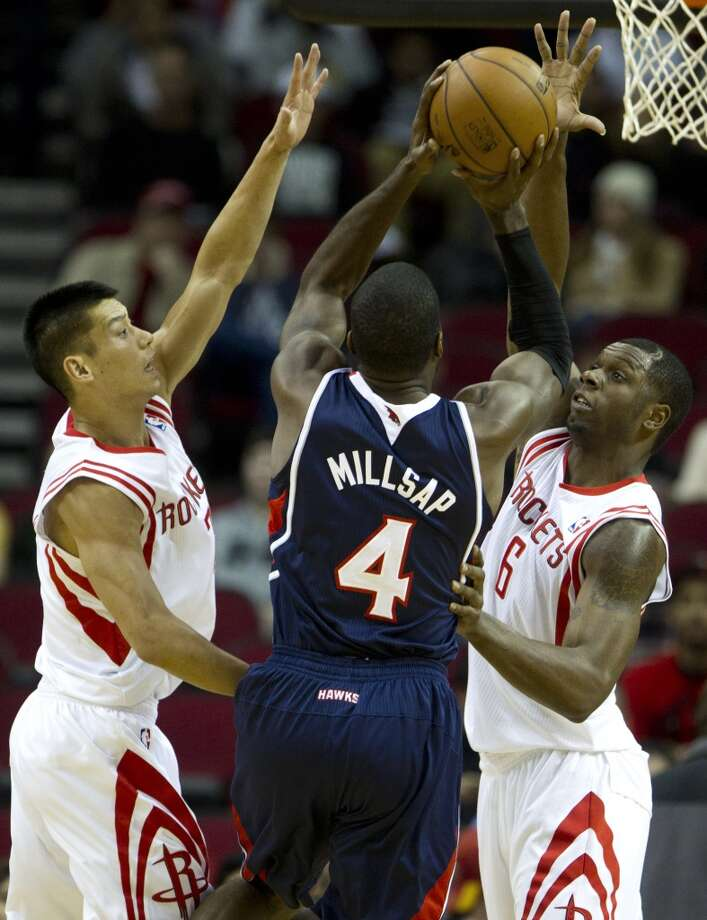Nov. 27: Rockets 113, Hawks 84   Rockets point guard Jeremy Lin (7) and forward Terrence Jones (6) defend a shot by Hawks power forward Paul Millsap (4). Photo: Brett Coomer, Houston Chronicle