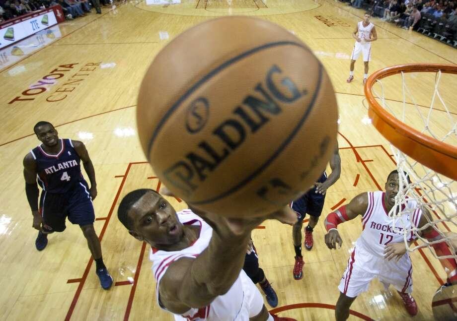 Rockets power forward Terrence Jones (6) drives to the basket past Hawks power forward Paul Millsap (4). Photo: Brett Coomer, Houston Chronicle