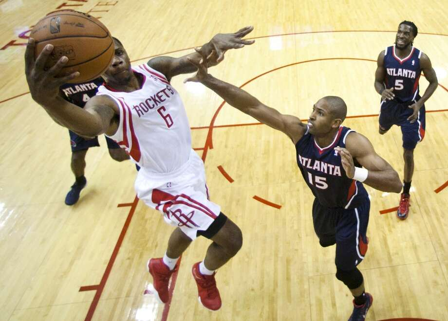 Rockets power forward Terrence Jones (6) drives to the basket past Hawks center Al Horford (15). Photo: Brett Coomer, Houston Chronicle