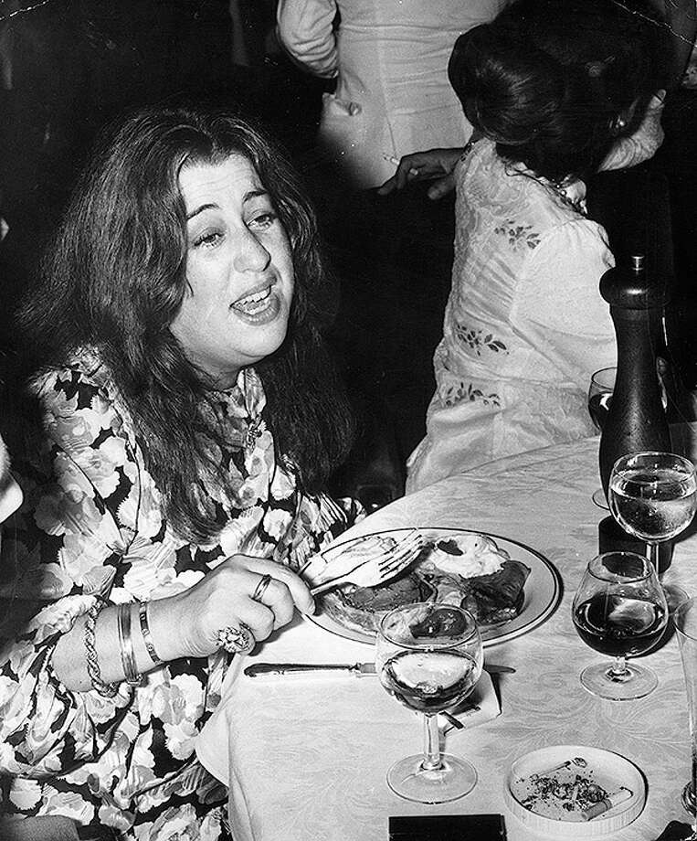 American musician Mama Cass Elliot (1941 - 1974) formerly of the Los Angeles folk-pop harmony group the Mamas and the Papas, eats at a party at Crockford's casino in London, circa 1974. Photo: Joe Bangay, Getty Images / Getty Images 2011