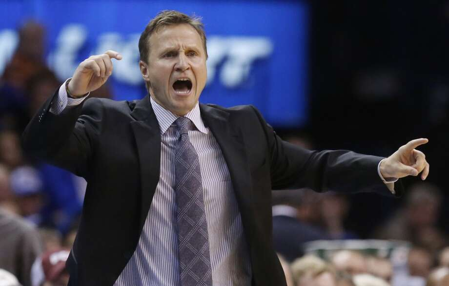 Oklahoma City Thunder head coach Scott Brooks shouts in the fourth quarter of an NBA basketball game against the San Antonio Spurs in Oklahoma City, Wednesday, Nov. 27, 2013. Oklahoma City won 94-88. (AP Photo/Sue Ogrocki) Photo: Associated Press