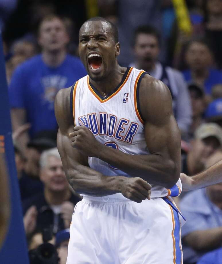 Serge Ibaka reacts after missing a dunk against San Antonio Spurs in the fourth quarter of an NBA basketball game in Oklahoma City, Wednesday, Nov. 27, 2013. Oklahoma City won 94-88. (AP Photo/Sue Ogrocki) Photo: Associated Press