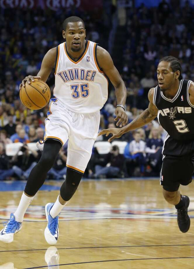 Oklahoma City Thunder forward Kevin Durant (35) drives past San Antonio Spurs forward Kawhi Leonard (2) in the first quarter of an NBA basketball game in Oklahoma City, Wednesday, Nov. 27, 2013. (AP Photo/Sue Ogrocki) Photo: Associated Press